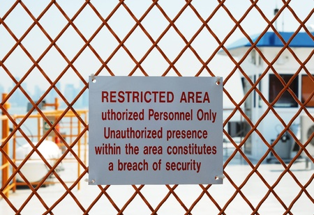 A security sign outside a restricted area photo