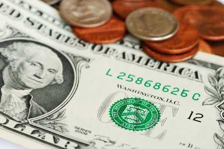 Close up view of the One Dollar bill and some coins Stock Photo - 10184060