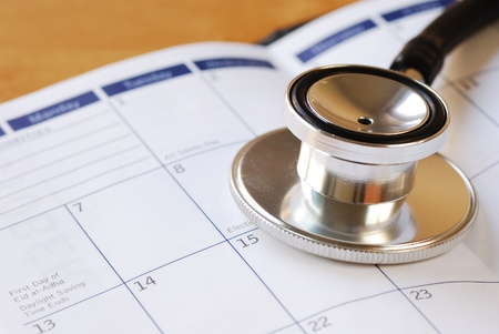 checkup: A stethoscope on the calendar concepts of medical appointment