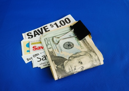 frugal: Cut up some coupons to save money  Stock Photo