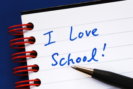 Writing the words I love School in the notebook concept of education Stock Photo - 11532113