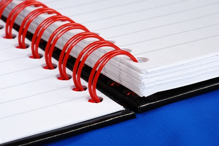 Close up view on the red spiral rings notebook concept of education or business meeting Stock Photo - 11532112