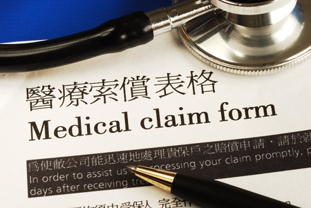Complete the medical claim form concept of medical insurance Editorial