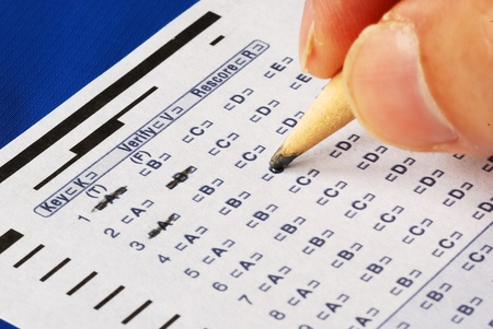 Fill in the computer grade answer sheet from a test or examination photo