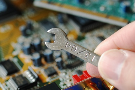 Repair of the circuit board in a computer  Stock Photo - 11520909