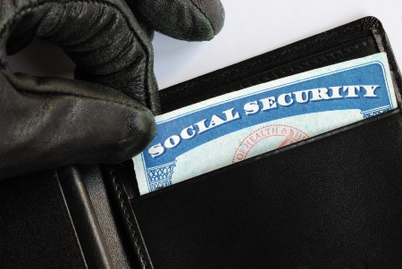 data theft: Social Security theft concept of identity theft Stock Photo
