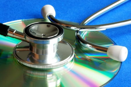 Stethoscope on CD concepts of information integrity and data security Stock Photo - 15747919