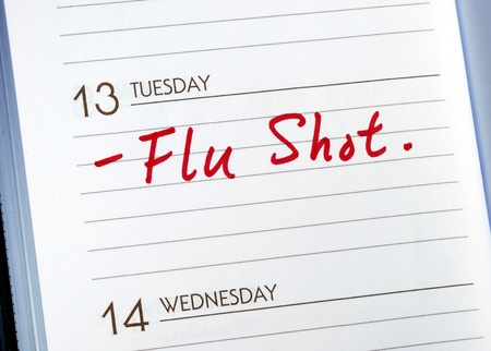 cure prevention: Mark the date on the day planner to have a flu shot Stock Photo