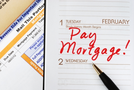 bill payment: Be sure to pay the home mortgage on time Stock Photo
