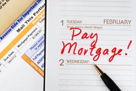 Zorg ervoor dat u de hypotheek op tijd te betalen Stockfoto