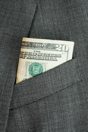 Money in a business suit pocket concepts of business finance Stock Photo - 16324836