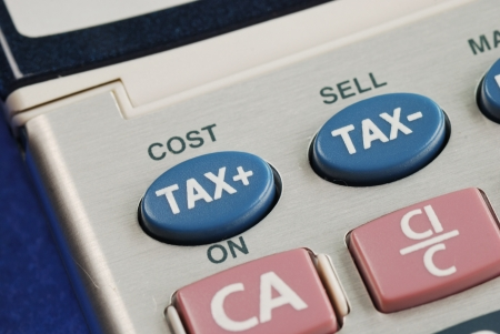 Calculate the tax and the cost with a calculator Stock Photo - 16328243