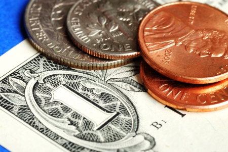 Coins and dollar bill concepts of money investing and wealth Stock Photo - 16324815