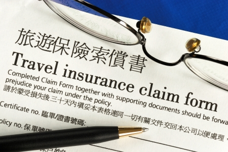 cancellation: Travel insurance claim form in both English and Chinese Stock Photo