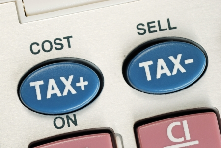 Calculate the tax and the cost with a calculator Stock Photo - 16328208