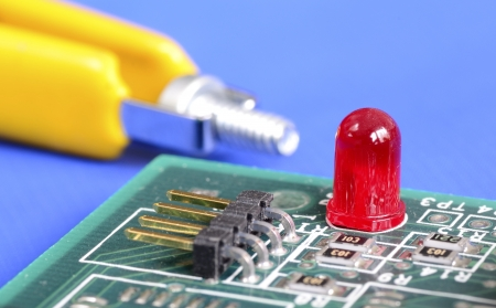A red warning lamp in a computer hardware concept of troubleshooting and maintenance Stock Photo - 17264744