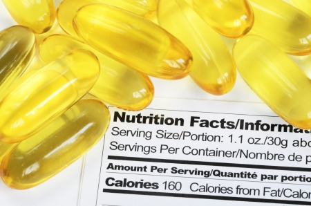 totals: Nutrition label with fish oil pills concept healthy eating