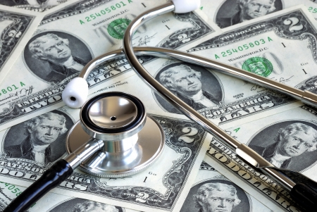 A stethoscope on some money concept of rising medical cost  photo