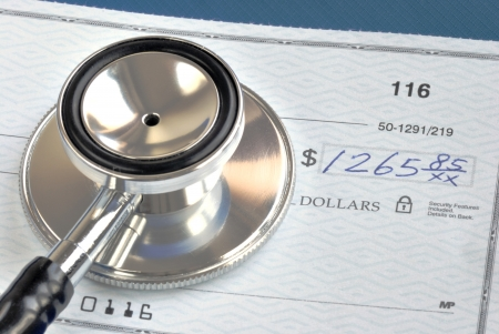 Rising medical cost in the United States isolated on blue Stock Photo - 17534137