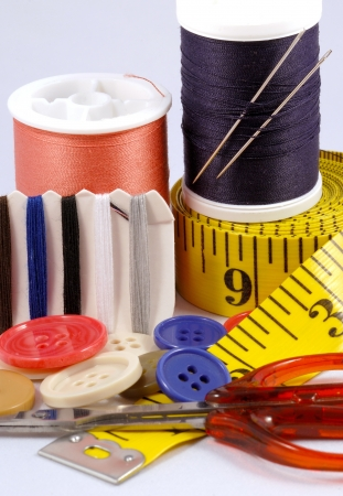 Some sewing tools such as threads, needles, buttons, and scissors Stock Photo - 17610265