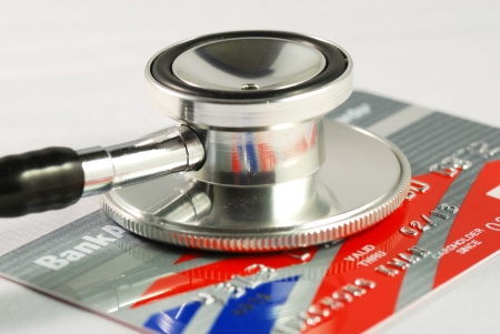 A stethoscope on the credit card concepts of checking the financial health and security Stock Photo - 17610255