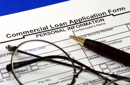 File the commercial loan application isolated on blue Stock Photo - 17610261