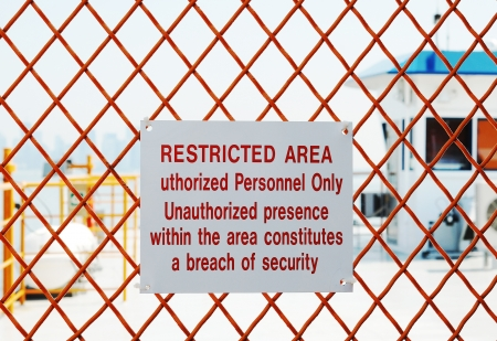 A security sign outside a restricted area Stock Photo - 17610260