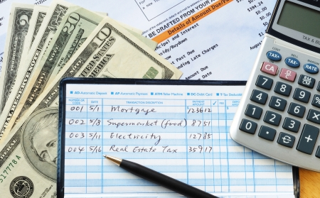 checkbook: Write some checks to make payments for household expenses  Stock Photo
