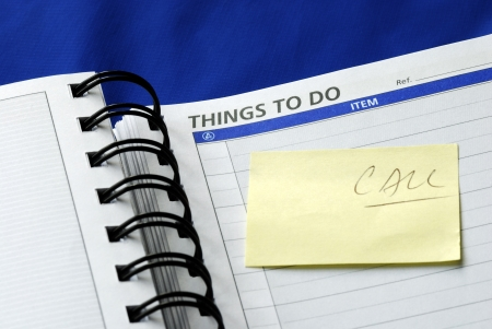 """""""To Do List"""" on the day planner isolated on blue Stock Photo"""