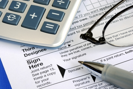 Complete and sign the income tax return isolated on blue Stock Photo - 17710506