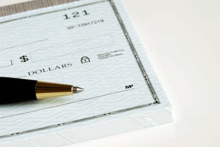 chequera: Escriba el monto en dólares del cheque Foto de archivo