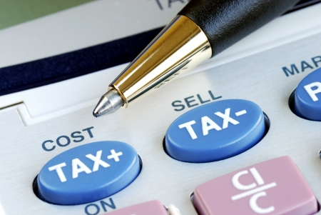 Determine the tax and the cost with a calculator Stock Photo - 17710486