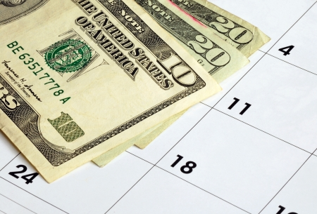 Money on a calendar concepts of financial planning Stock Photo - 17710508