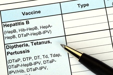 Filling the vaccination record concept of disease prevention and immunization Stock Photo