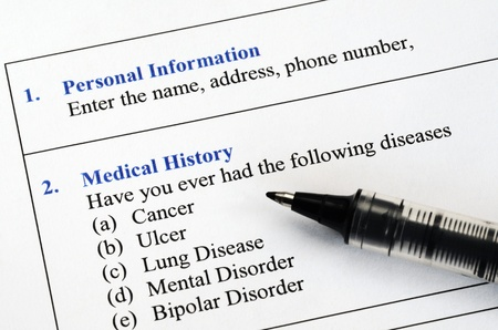 Filling the patient personal information and medical history questionnaire Banco de Imagens