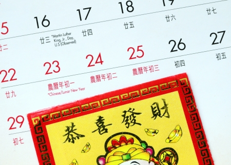 Chinese New Year marked on the calendar and a red lucky-money envelope