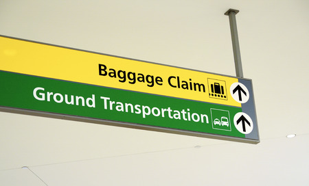 Baggage claim and Ground Transportation sign concept of travel Editorial