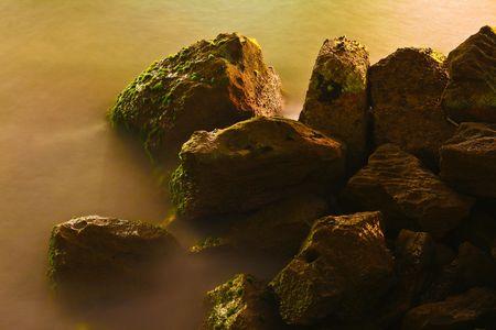 myst: long exposure of water splashing against some old port rocks