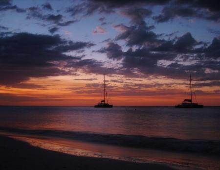 Catamarans at sunset