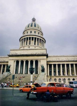 car broken down in front of the Capitol building in Havana