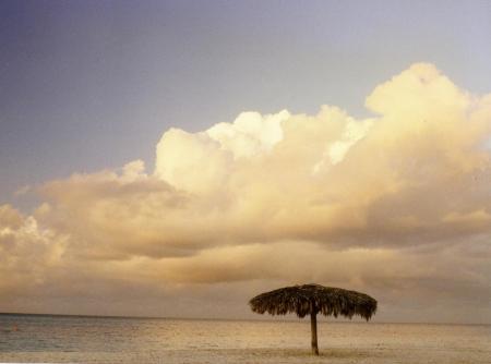 isolated beach palapa at sunset