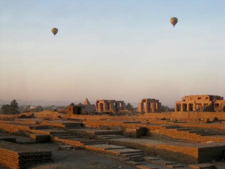 hot air ballons over desert landscape