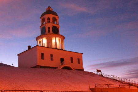 The historic Town Clock on Citadel Hill at sunset just after a snow fall in Halifax, Nova Scotia Canada