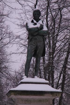 Statue of Robbie Burns, Scottish poet, covered in snow