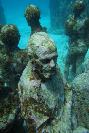 Sunken statues in the waters off Cancun Mexico  This one reminds me of a philosopher contemplating his situation