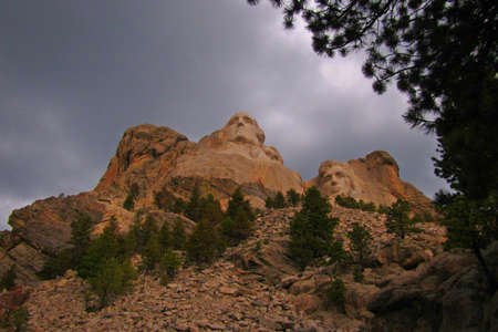 Mount Rushmore with impending storm approaching