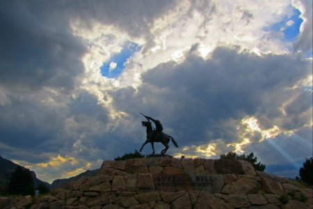 Statue of Wild Bill Cody against a dramatic sky  Stock Photo