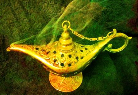 Alladins lamp appears to have Genie or Jinn appearing