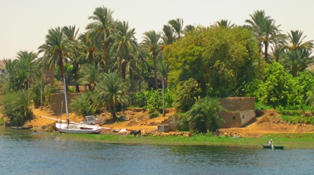 nile river: Nile river bank with fishing boat on bank