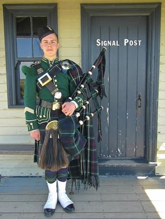nova scotia: Bagpiper in Halifax Nova Scotia in Scottish Tartan